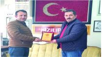 Türkiye Gazeteciler Federasyonundan Plaket